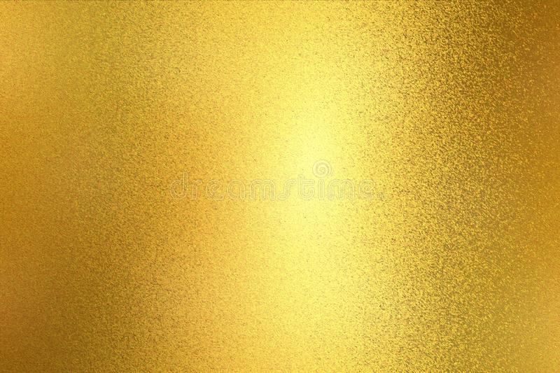 Glowing light gold paint steel wall texture, abstract pattern background stock photos