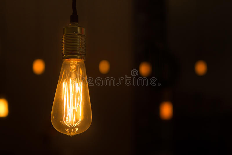 Download Glowing Lightbulb Dangling From The Ceiling Stock Photo - Image of switching, physics: 35585026