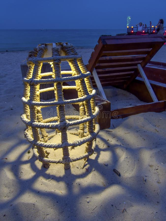 Glowing marine rope lamp, unusual lamp on the beach at night royalty free stock images