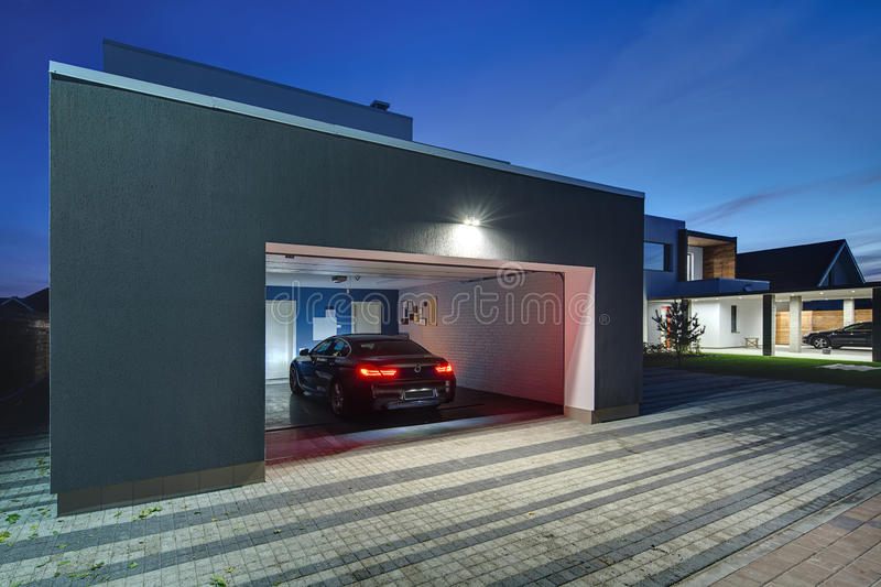 Glowing modern cottage with garage stock images
