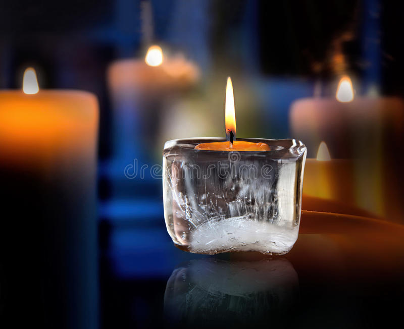 Glowing mourning candle. Image of a glowing mourning candle royalty free stock image