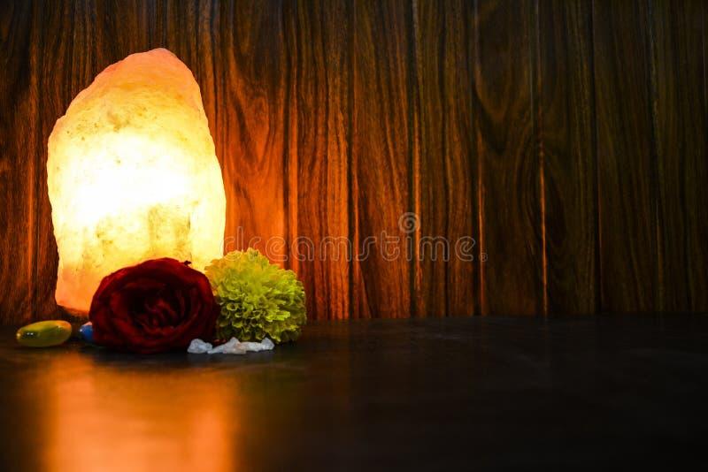 Glowing Natural Salt Lamp   Himalayan Salt royalty free stock photo