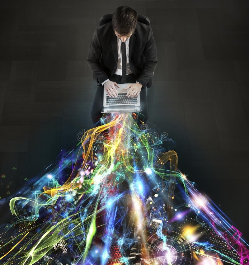Glowing network. Man sitting with laptop and light beams stock photo