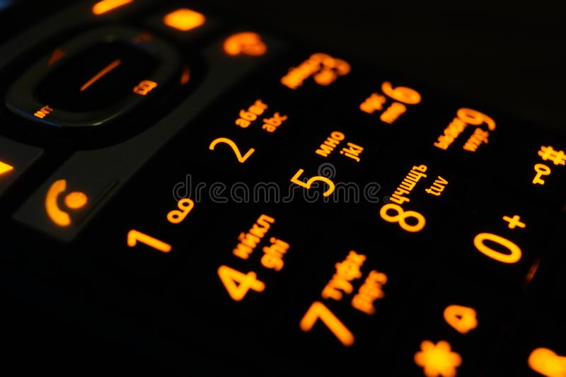 Glowing phone buttons in the dark macro shot, selective focusing stock image