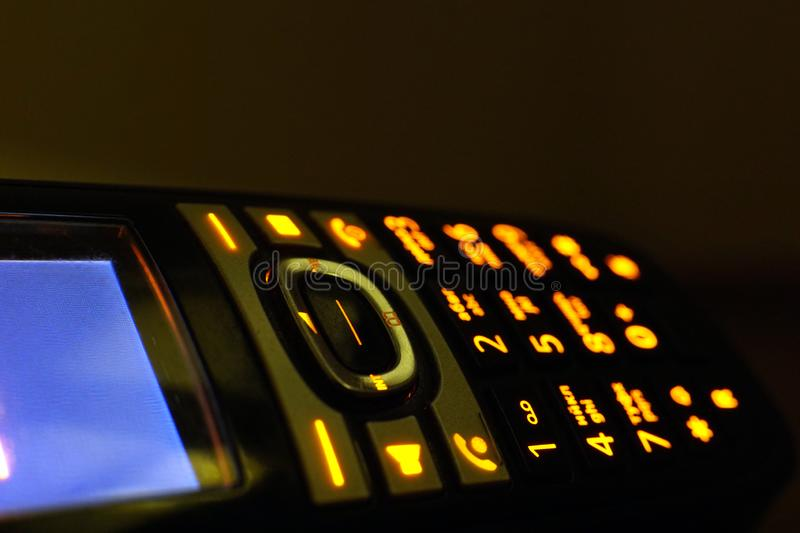 Glowing phone buttons in the dark macro shot, selective focusing royalty free stock photography