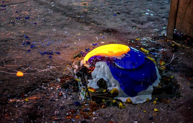 Colorful melted glass in a glowing pile, at a glass factory. A glowing pile of colorful glass is wasted glass, removed from a kiln at a glass factory royalty free stock photo