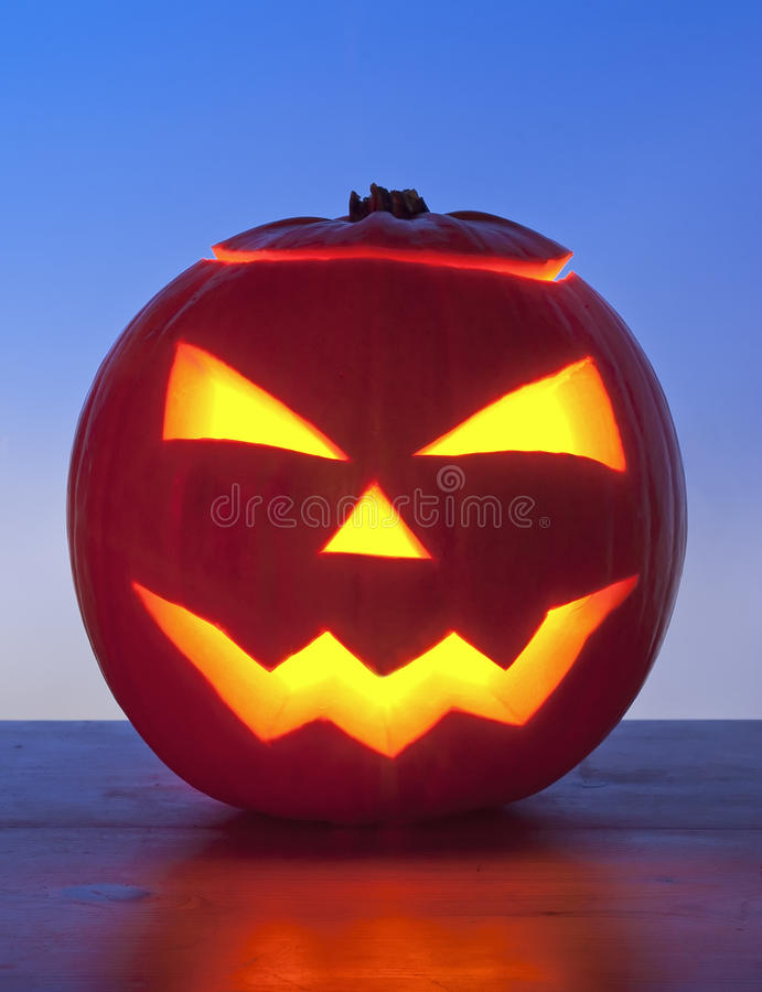 Glowing Pumpkin on Blue Background stock photography