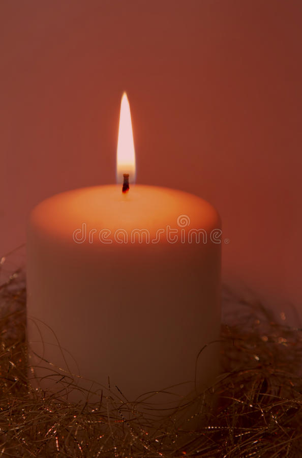 Glowing Red Christmas Candle Royalty Free Stock Photography