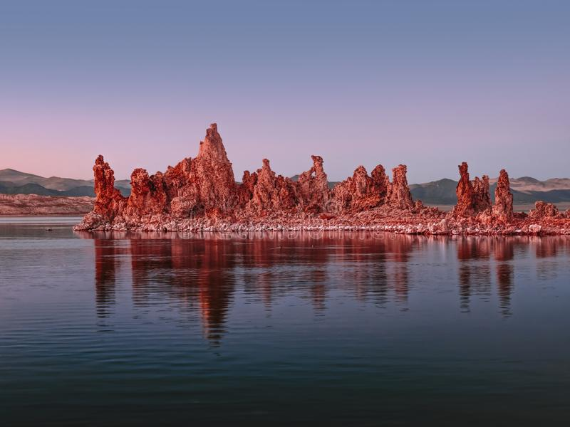 Glowing rocks at colorful sunset on Mono Lake in the Eastern Sierras royalty free stock photography