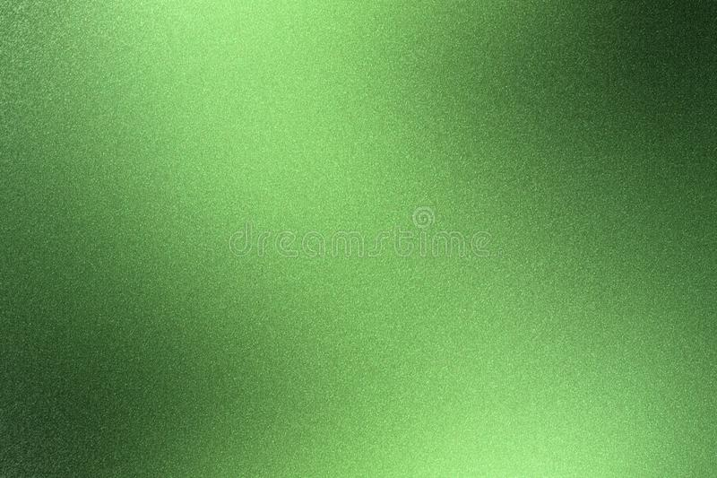 Glowing rough green metal wall surface, abstract texture background royalty free stock photo