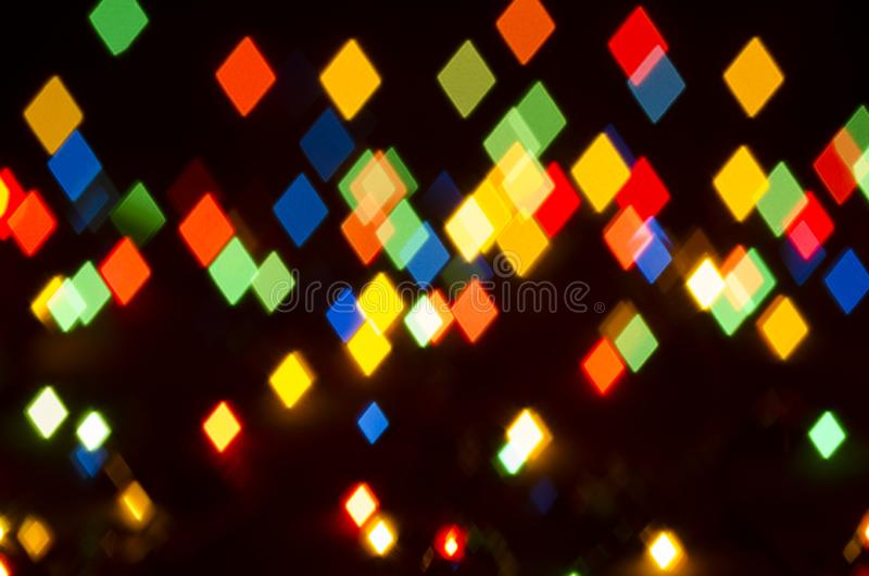A glowing shape diamonds colored on a black background royalty free stock images