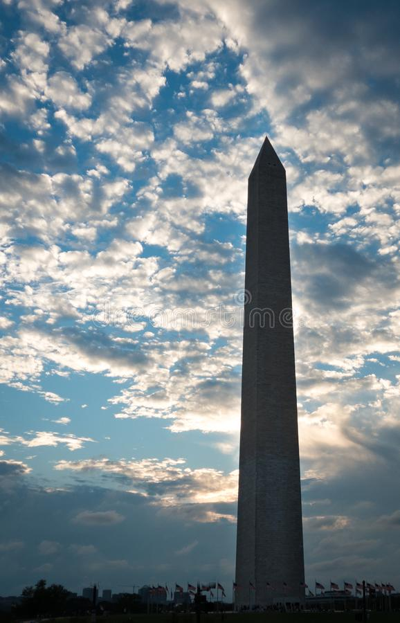 Glowing silhouette of Washington Monument in Washington D.C. at sunset with clouds in background royalty free stock photos