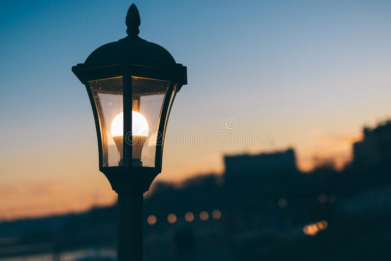 Glowing street lamp in the city royalty free stock image