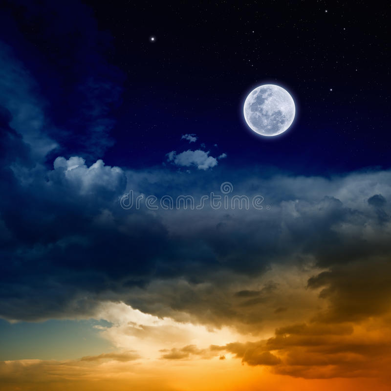 Glowing sunset and full moon stock photo