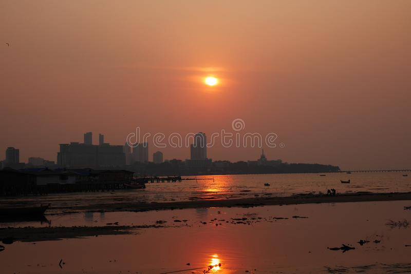 Glowing Sunset over the bay in Naklua Thailand at low tide royalty free stock image