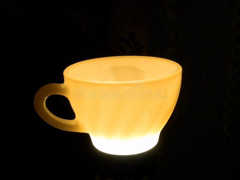 Glowing Tea Cup royalty free stock images