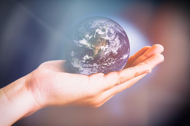 The glowing world in a child`s hand royalty free stock image