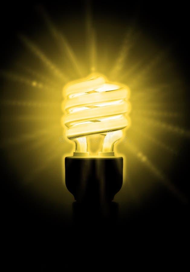 Glowing Yellow Light Bulb stock photos