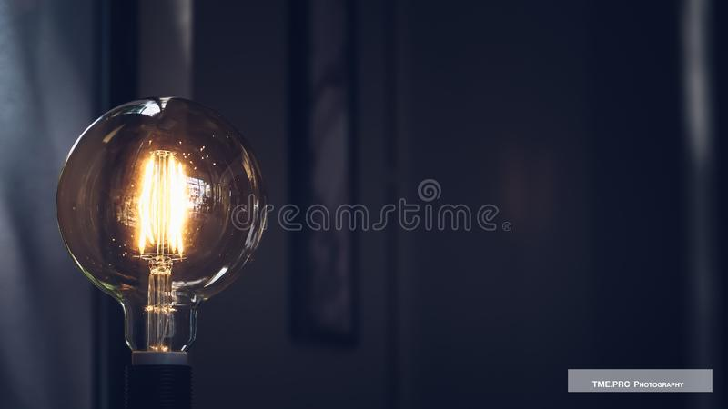 Glowing yellow light bulb, Realistic photo image turn on tungsten light bulb. Energy and idea symbol stock images