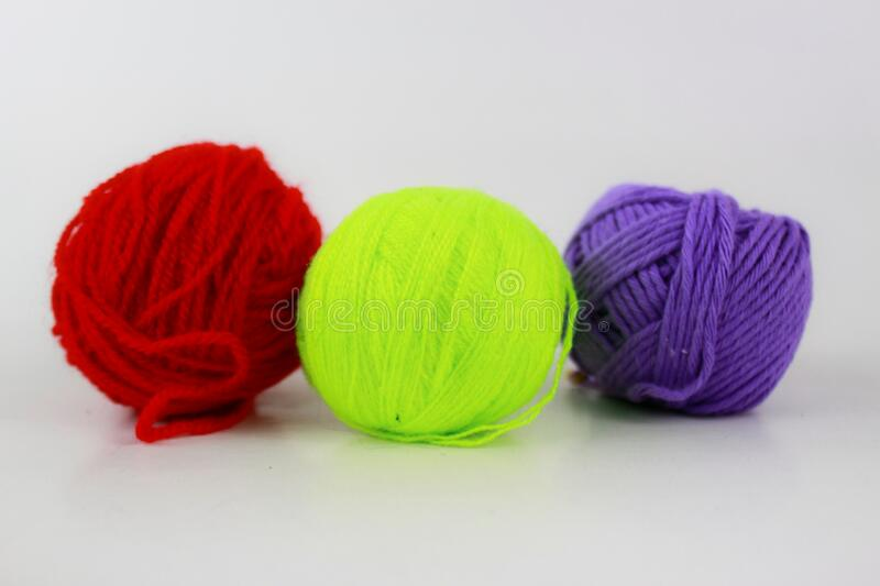 Glowing yellow, red and purple yarn closeup isolated on white background royalty free stock images