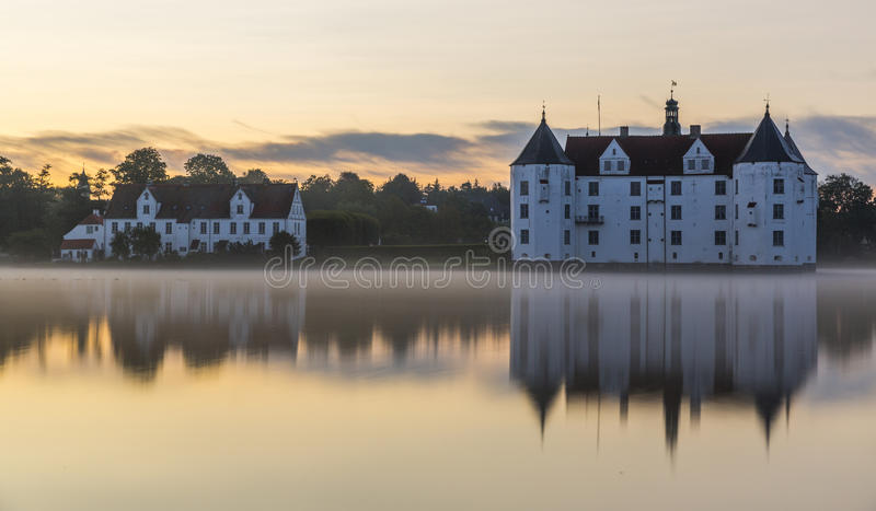 Glucksburg water castle at dawn, Germany stock photography