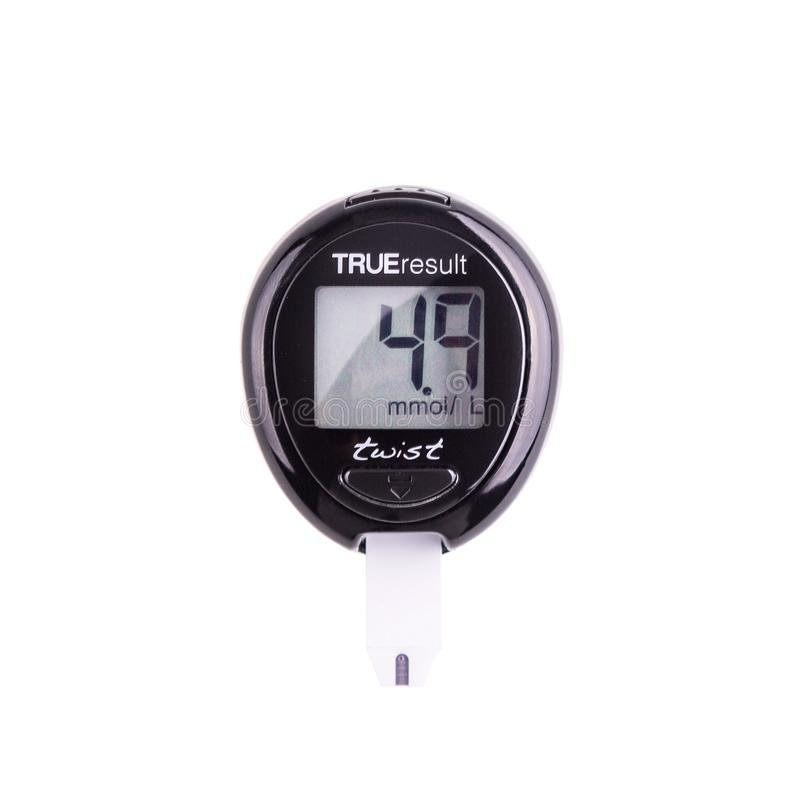 Glucometer for checking blood sugar levels on a white background stock photos