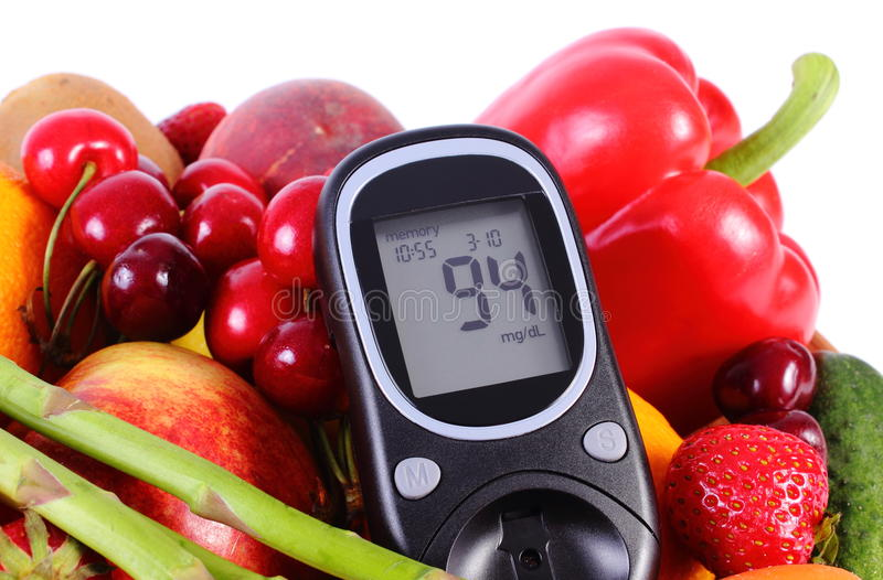Glucometer with fruits and vegetables, healthy nutrition, diabetes stock image