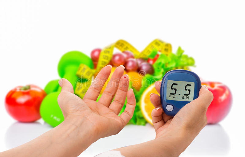 Glucometer for glucose level and healthy organic food on a white background. Diabetes concept. Glucometer for glucose level and healthy organic food on a white royalty free stock photo