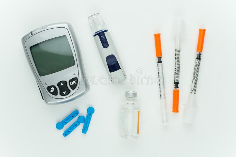 Glucometer and other blood sugar supplies. stock images