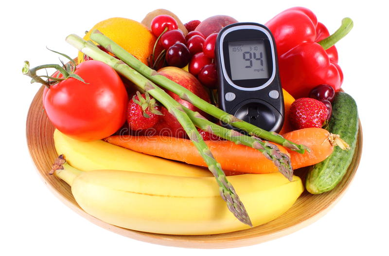 Glucometer z owoc i warzywo, zdrowy odżywianie, cukrzyce zdjęcia stock