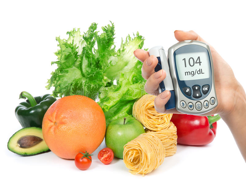 Glucose level blood test meter in hand and healthy organic food stock photos