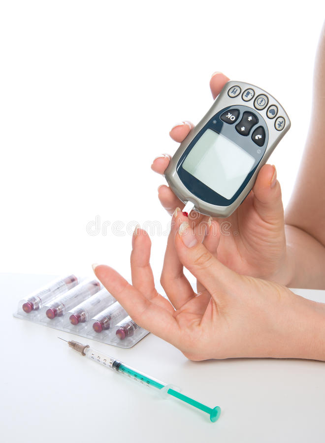 Glucose level blood test using mini glucometer and small drop of. Diabetes patient measuring glucose level blood test using mini glucometer and small drop of royalty free stock photography
