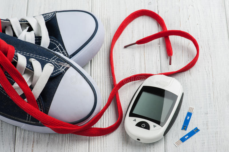 Glucose meter, gumshoes, red heart stock images