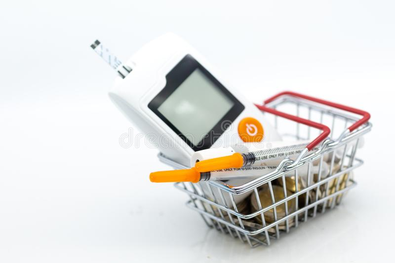 Glucose meter and injection needle on cash basket , image use for health care concept.  stock photography