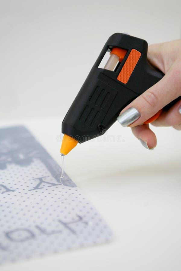 Glue gun usage stock image