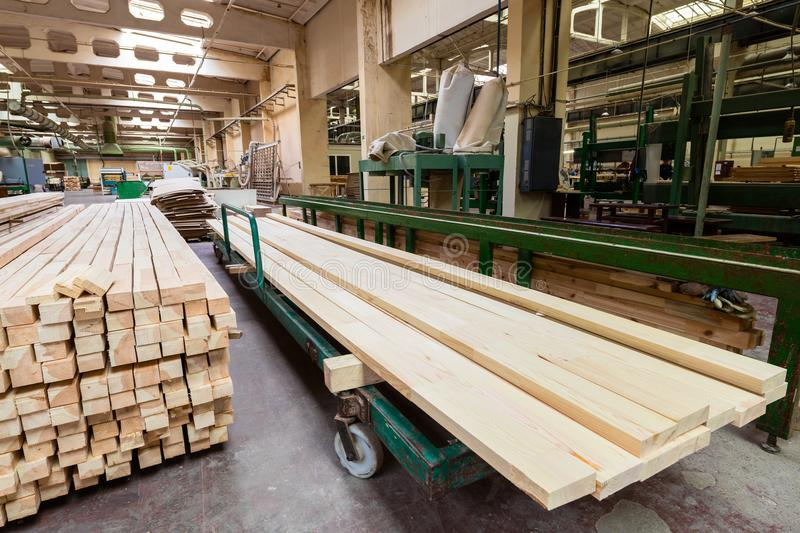 Glued pine timber beams in woodworking factory stock photos