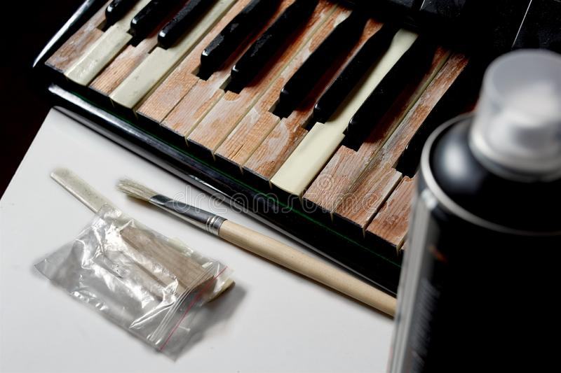 Old musical instrument repair stock photo