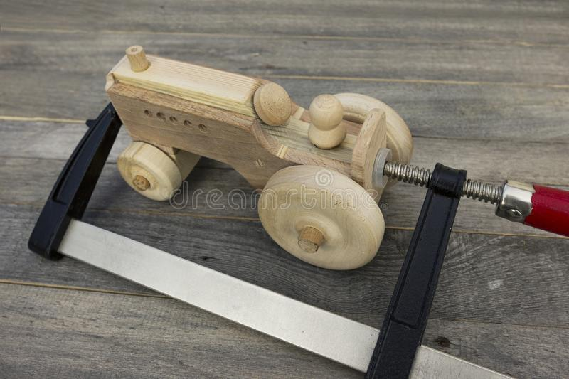 Gluing process. Handmade wooden toy on old table royalty free stock photos