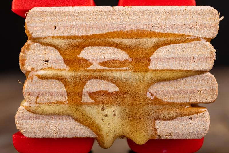 Gluing wood with waterproof adhesive. Pieces of wood pressed together with carpentry clamps. Place - carpentry workshop, art, artisan, assemble, c-clamp royalty free stock photos