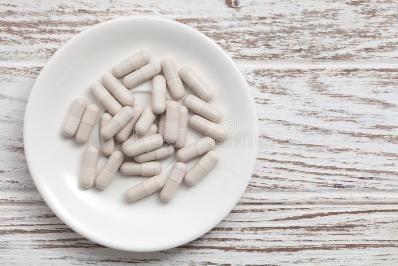 Glutathione supplement antioxidant still life. Alternative healthy white background stock image