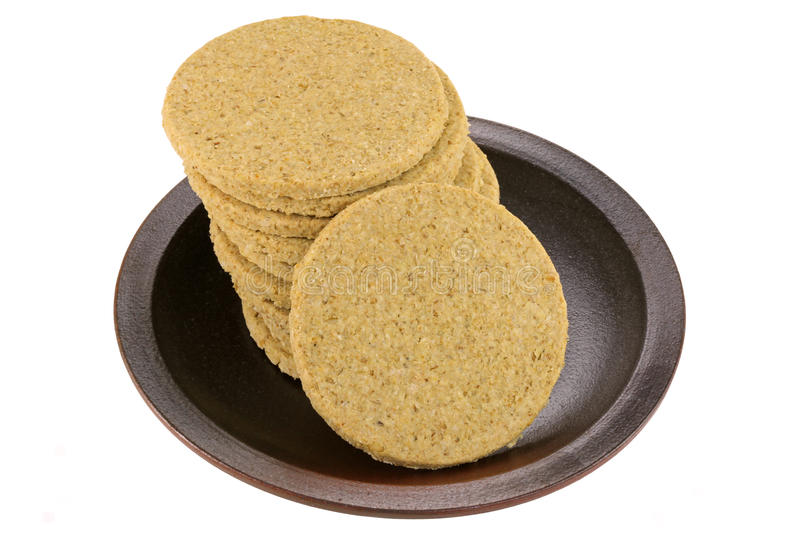 Gluten free crumbly rough Oatcakes. A dish of gluten free crumbly rough Oatcakes, isolated on white background stock photos
