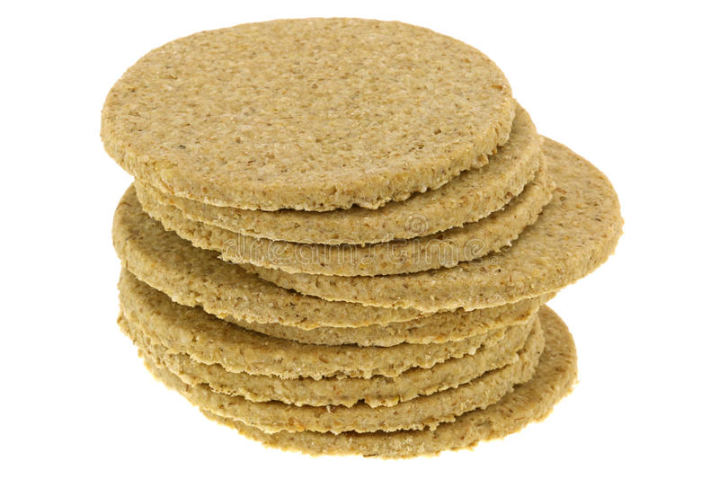 Gluten free crumbly rough Oatcakes. A stack of gluten free crumbly rough Oatcakes, isolated on white background royalty free stock photography
