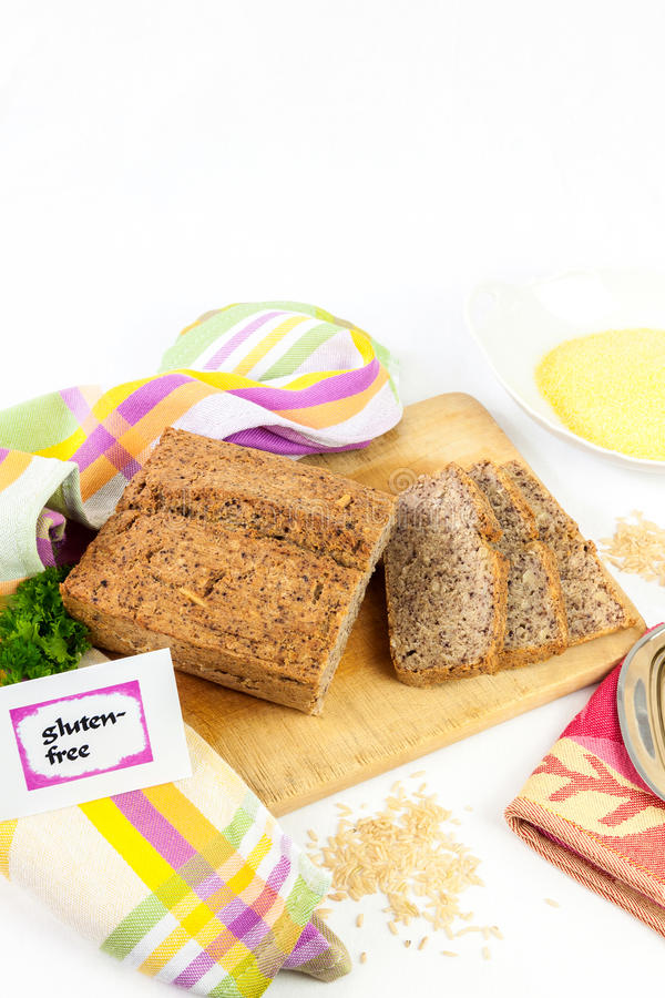 Gluten-free diet. Wooden board with homemade, gluten-free wholemeal bread from rice and corn, isolated stock images