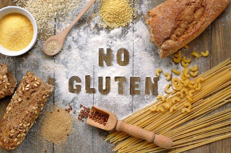 Gluten free flour and cereals millet, quinoa, corn flour polenta, brown buckwheat, basmati rice and pasta with text gluten free in. Gluten free flour and cereals stock image