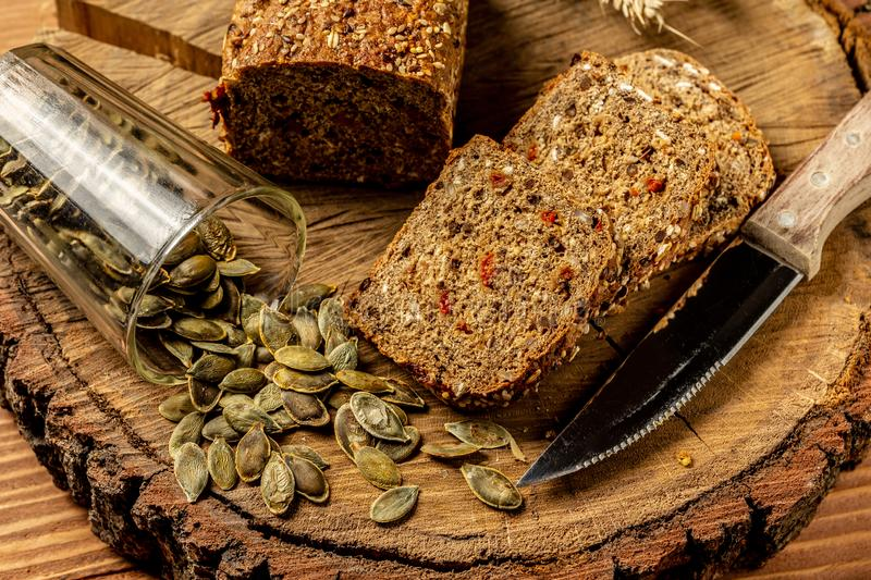 Gluten free food. bread and snacks with seeds, walnut, goji berry on wooden background from top view. Healthy and diet concept.  royalty free stock images