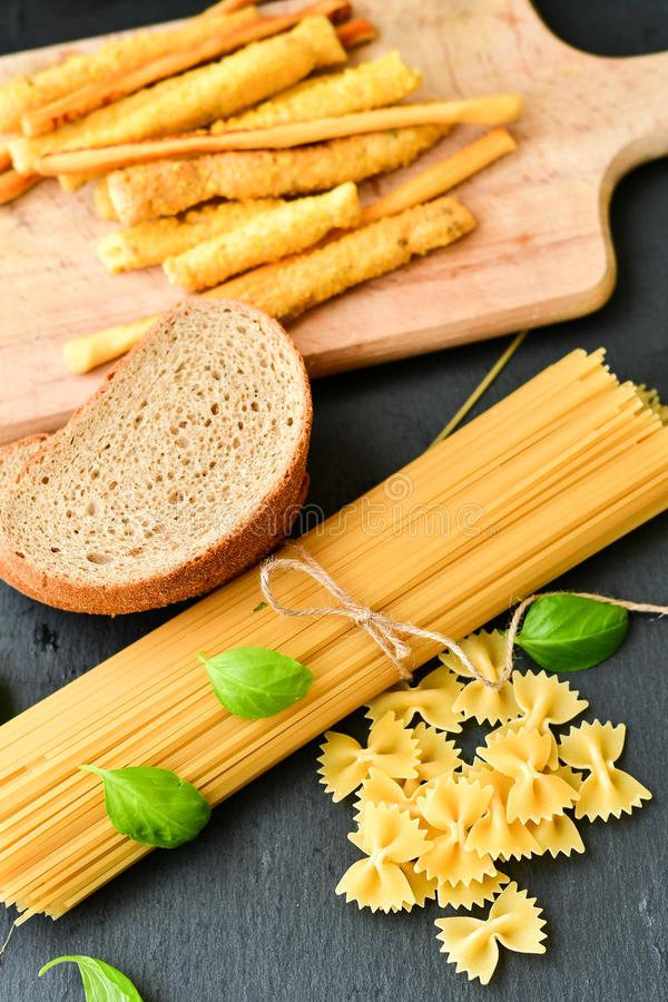 Gluten free food. Different types of grissini , bread and pasta- Selection of gluten free food stock photo