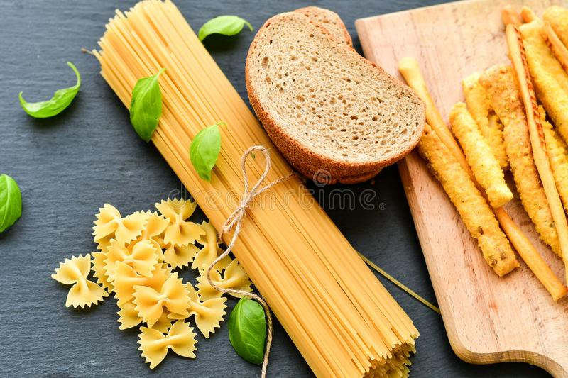 Gluten free food. Different types of grissini , bread and pasta- Selection of gluten free food royalty free stock images