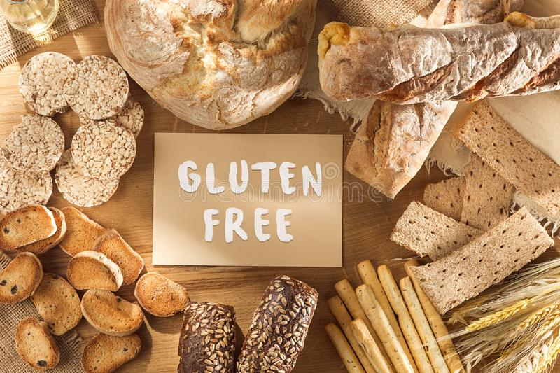 Gluten free food. Various pasta, bread and snacks on wooden background from top view stock images