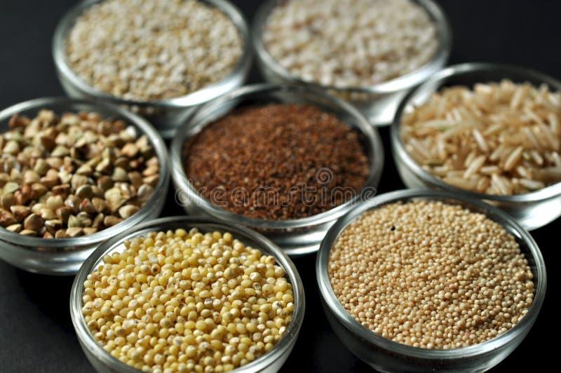 Gluten-free grains on black background stock photo