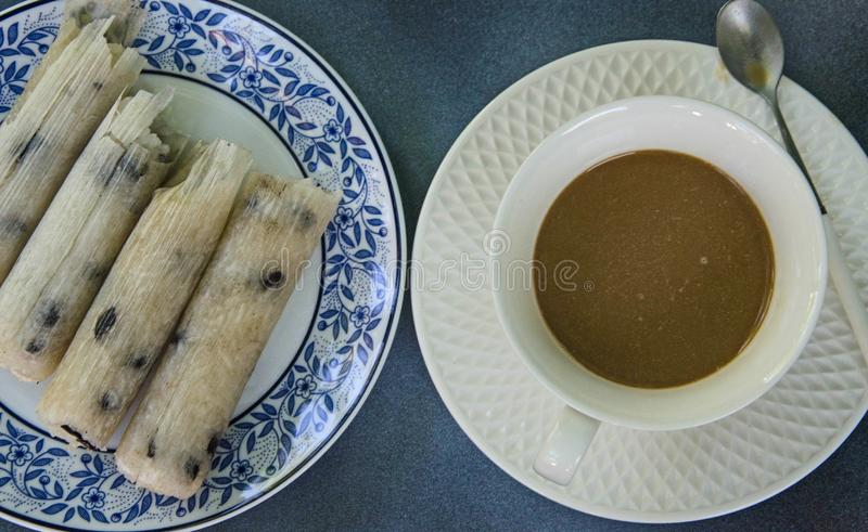 Glutinous rice roasted in bamboo joints and coffee cups royalty free stock photo